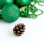 Green Christmas balls and fir-cone. — Foto Stock