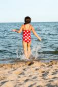 Little girl walks into the sea — Stock Photo