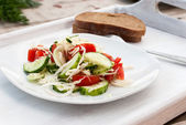 Salad in a bowl of tomato, cucumber,  — Stock Photo