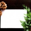 Christmas card with pine cones and spruce branches — Stock Photo #77257110