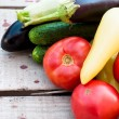 Autumn vegetables on the table - tomatoes, peppers, eggplant, zu — Stock Photo #79219100