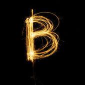 Sparkler firework light alphabet B. — Stock Photo