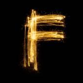 Sparkler firework light alphabet F. — Stockfoto