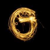 Sparkler firework light alphabet G. — Zdjęcie stockowe