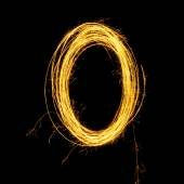 Sparkler firework light alphabet O and number zero. — Stock Photo
