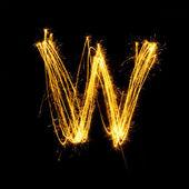 Sparkler firework light alphabet W. — Zdjęcie stockowe