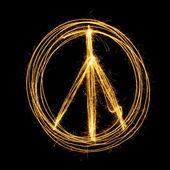 Sparkler firework light with peace sign. — Zdjęcie stockowe