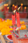 Burning candle in pot at chinese shrine. — Stock Photo