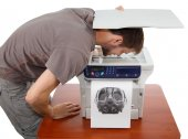 Man scanning his face in copier — Stock Photo
