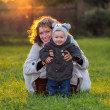 Happy young mother and her little son on the grass — Stock Photo #59718007