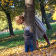 Mother plays with her little son in the park — Stock Photo #59718097