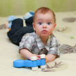 Very surprised baby boy lying on the bed — Stock Photo #60481515