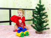 Baby boy playing with Santa Claus hat at home — Stock Photo
