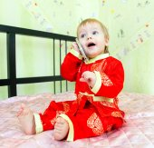 Funny little boy calls the room service in hotel by his telephon — Stock Photo