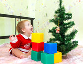 Funny little boy with open mouth looks at new year fir — Stock Photo
