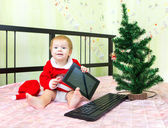 Boy is happy to get New Year present tablet computer — Stock Photo