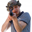 Big eye of aiming shooter in telescopic scope — Stock Photo #62286437