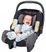 Pleased baby sitting in car seat — Stock Photo