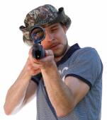 Big eye of aiming shooter in telescopic scope — Stock Photo