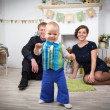 Happy family with one year old child at home — Stock Photo #69433351