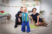 Happy family with one year old child at home — Stock Photo