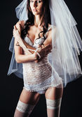 Sexy beautiful nude bride with veil in white erotic lingerie on a black background. beauty portrait of woman — Stock Photo