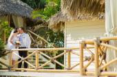 Young loving couple on tropical sea background - wedding at the beach. — Stock Photo
