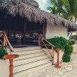 Table setting in tropical Outdoor restaurant at the beach. Cafe on seashore, ocean and sky. Dominican Republic, Caribbean. Relax. remote Paradise. — Stock Photo #71044127