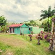 Poor woden cabins at Dominican Republic, island Hispanola wich is a part of Greater Antilles archipelago in Carribean region — Stock Photo #71047437