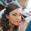 Woman applying make up for bride in her wedding day near mirror. Closeup of makeup artist — Stock Photo #71345063