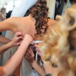 Bridesmaid is helping the bride tying bow on wedding dress. — Stock Photo #71348073