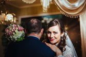 Charming bride and groom on their wedding celebration in a luxurious restaurant. — Stock Photo