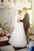 Wedding dance of charming bride and groom on their wedding celebration in a luxurious restaurant — Stock Photo