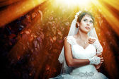 Portrait of beautiful young bride holding bright bouquet in hands. wedding celebration. nature green background. woman alone outdoors at the park — Stock Photo