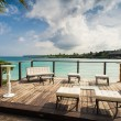 Outdoor restaurant at the beach. Cafe on the beach, ocean and sky. Table setting at tropical beach restaurant. Dominican Republic, Seychelles, Caribbean, Bahamas. Relaxing on remote Paradise beach. — Stock Photo #71707373