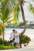 Young loving couple on tropical sea background - wedding on beach — Stock Photo