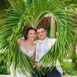 Young loving couple on tropical sea background - wedding on beach — Stock Photo #71713883