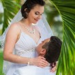 Young loving couple on tropical sea background - wedding on beach — Stock Photo #71726367