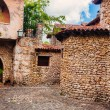 Road in park. Ancient village Altos de Chavon - Colonial town reconstructed in Dominican Republic. Casa de Campo, La Romana, Dominican Republic. Ponderosa-style, tropical seaside resort — Stock Photo #71735487