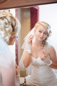Bride getting ready. beautiful bride in white wedding dress with hairstyle and bright makeup. Happy sexy girl waiting for groom. Romantic lady in bridal dress have final preparation for wedding. — Stock Photo