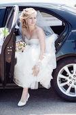 Portrait of a pretty bride in a car.  close-up portrait of a pretty shy bride in a car window. — Stock Photo