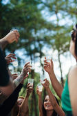 Close-up human hands holding glasses of champagne — Stock Photo