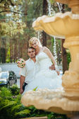 Bride with Groom at wedding Day walking Outdoors on spring nature. Bridal couple, Happy Newlywed woman and man embracing in green park. — Stock Photo