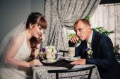 Bride and groom in luxurious restaurant drink a cup of Coffee latte  with heart design on their wedding or Valentines day date. — Stock Photo