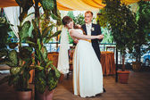 Young bride and groom in the park, bridal bouquet, wedding dresses — Stok fotoğraf