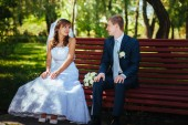 Bride and Groom at wedding Day walking Outdoors on spring nature. Bridal couple, Happy Newlywed couple embracing in green park. — Stock Photo
