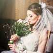 Portrait beautiful bride with bouquet of flowers on luxury interior in wedding day — Stock Photo #72197267