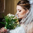 Portrait beautiful bride with bouquet of flowers on luxury interior in wedding day — Stock Photo #72197275