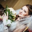 Portrait beautiful bride with bouquet of flowers on luxury interior in wedding day — Stock Photo #72197315