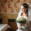 Portrait beautiful bride with bouquet of flowers on luxury interior in wedding day — Stock Photo #72198119